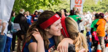 Image of two females celebrating at London Superhero Run finish line