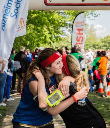 Image for female runners celebrating at London Superhero Run finish line